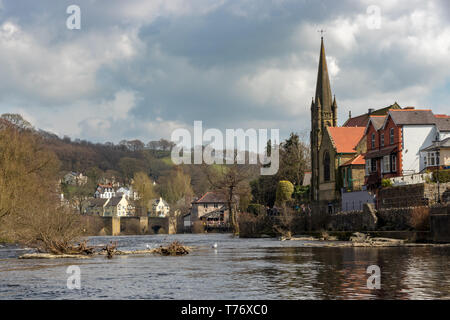 Llangollen bridge and church view from the River Dee surrounded by the Welsh countryside in early spring time - Stock Photo