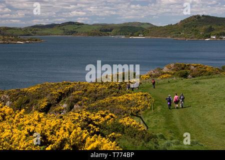 hikers on coastal path to Rockliffe & Kippford, Rough Firth, Dumfries & Galloway, Scotland - Stock Photo
