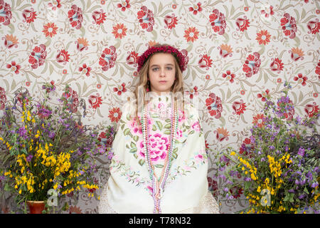 Madrid, Spain. 5th May, 2019. Portrait of the 'Maya' Sara sitting on her altar sourrounded by lavender, thyme and other wild flowers. - Stock Photo