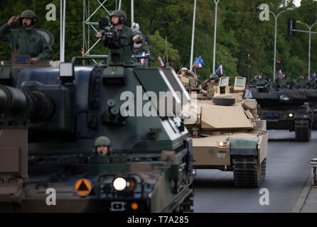 An M1A2 Abrams Tank and crew (middle) from 2nd Battalion, 34th Armored Regiment, 1st Infantry Division from Fort Riley, Kansas, participate in the Poland Constitution Day Parade in Warsaw, Poland, May 3, 2019. Approximately 30 Soldiers from 2nd Bn, 34th Armored Regt., 1st ABCT, 1st ID and four Soldiers from 5th Battalion, 7th Air Defense Artillery out of Baumholder, Germany, took part in Poland's Constitution Day Parade. (U.S. Army photo by Sgt. Thomas Mort) - Stock Photo