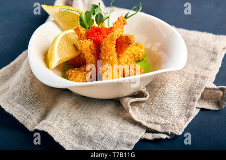 fried shrimps in batter with spinach sauce - Stock Photo