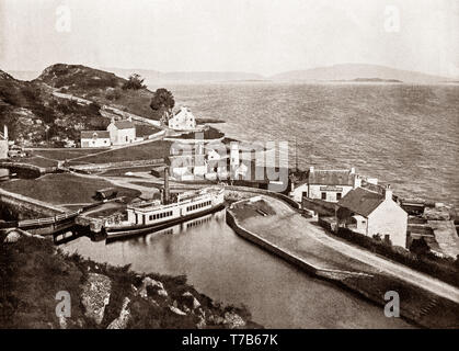 A late 19th Century view of the tiny harbour at Crinan,  a small village located on the west coast of Scotland in the region known as Knapdale, which is part of Argyll and Bute. Before the Crinan Canal was built, Crinan was named Port Righ which meant the king's port. The canal was named from the small settlement of Crinan Ferry on the edge of Loch Crinan where a small ferry landed and designed to provide a short cut between the west coast and islands at one end and the Clyde estuary at the other, and so avoid the long voyage around the south end of the Kintyre Peninsula. - Stock Photo