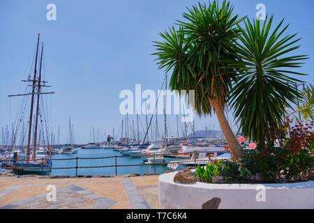 Playa Blanca, Lanzarote, Spain - April 29, 2019: yacht boats mooring in Rubicon port of Playa Blanca. Canary Islands are very popular holiday destinat - Stock Photo