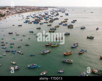 Fishing village in Mui Ne, Vietnam. A lot of old fishing boats in the poor fishing village of Vietnam. Top view. Aerial view - Stock Photo