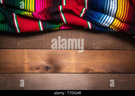 Mexican Serape blanket on wood Background - Stock Photo