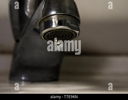 Leaking water drops from old rust and stained faucet, Save water concept old tap - Stock Photo