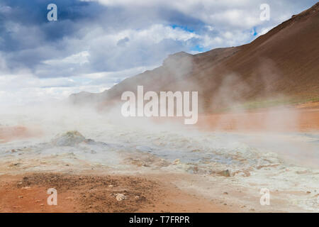 Landscape at Hverir, red sulphurous soil with fumaroles - Stock Photo