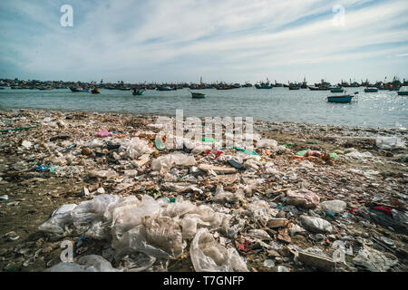 Garbage and basket boats on the beach. Bad environmental situation near the sea in Vietnam. MUI ne. Fishing village. - Stock Photo