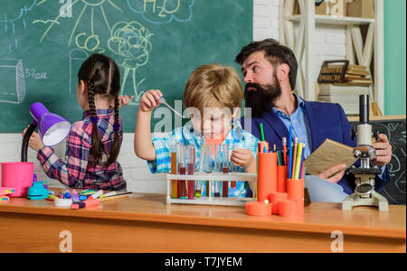 School chemistry laboratory. back to school. Science and education. chemistry lab. happy children teacher. Laboratory Research - Scientific project For Chemical test. Always question, Always wonder. - Stock Photo