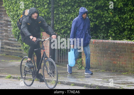 London, UK. 8th May, 2019. A man shelters from the rain in London during rain and wet weather. According to the Met Office, rain is forecasted for the next four days. Credit: Dinendra Haria/Alamy Live News - Stock Photo
