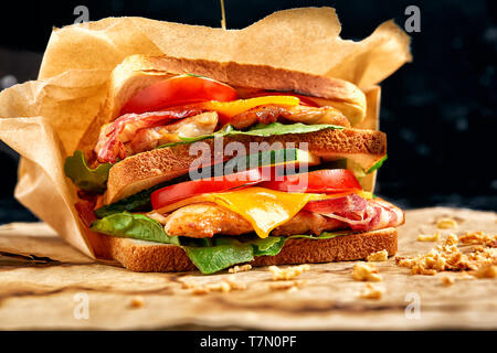 Freshly made clubsandwiches served on a wooden chopping board - Stock Photo
