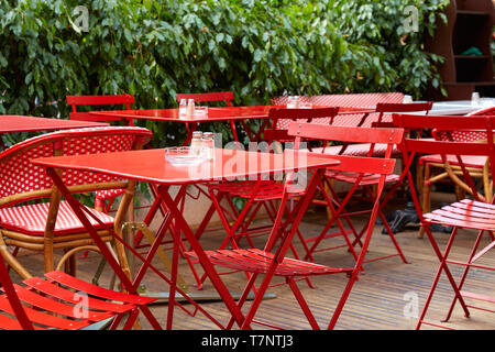Restaurant red outdoor tables and chairs in summer, nobody - Stock Photo