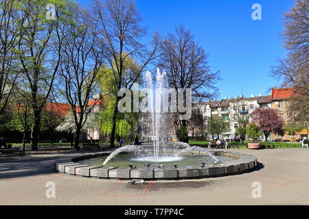 Katowice, Silesia / Poland - 2019/04/18: Panoramic view of the city park and fountain of the Plac Andrzeja square - Andrew square - in Katowice - Stock Photo