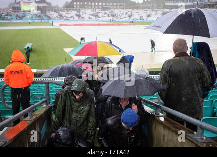 London, UK. 8th May 2019. UK Weather:  Ticket holders leave as heavy rain and hail  stops play during the first One Day International between England and Pakistan at The Kia Oval. Credit: Thomas Bowles/Alamy Live News - Stock Photo
