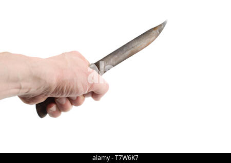 Old hunting knife in hand isolated on white background. - Stock Photo