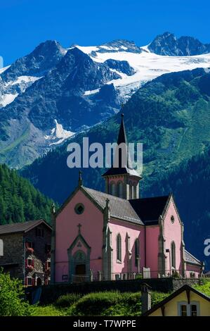 Switzerland, Valais, Tour du Mt Blanc, Trient, church with Pointe d'Orny in the back - Stock Photo