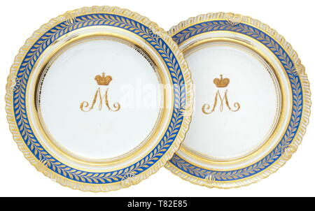 Two Russian plates from the grand duke's table service 2nd half of the 19th century. White glazed porcelain with royal blue border and gold floral decoration. In the centre a hand-painted, gilt monogram 'M' surmounted by a grand ducal crown. No mark. Diameter 24 cm. Partially minimally faded, otherwise in good condition. The plates at hand most likely belonged to the service of Grand Duke Mikhail Nikolaevich Romanov (1832 - 1909). historic, historical, 19th century, Additional-Rights-Clearance-Info-Not-Available - Stock Photo