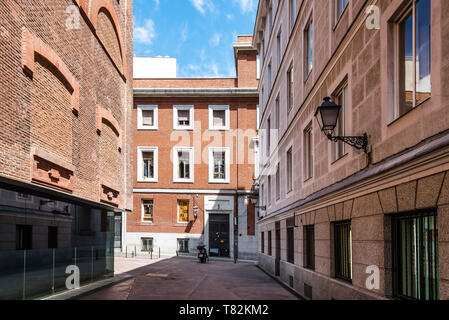 Madrid, Spain - May 2, 2019: Street in the picturesque Quarter of Las Letras. The neighbourhood is formed by narrow streets - Stock Photo