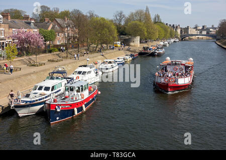 Pleasure boats moored along the River Ouse in spring York North Yorkshire England UK United Kingdom GB Great Britain - Stock Photo