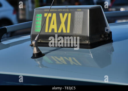 Playa Blanca, Lanzarote, Spain - April 27, 2019: Sign with the yellow word TAXI on a Spanish taxi car in Playa Blanca, Lanzarote. - Stock Photo