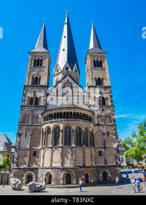 BONN, GERMANY - JUNE 06, 2014: The Bonn Minster with the sculptures depicting the heads of Saints Cassius and Florentius in front - Stock Photo