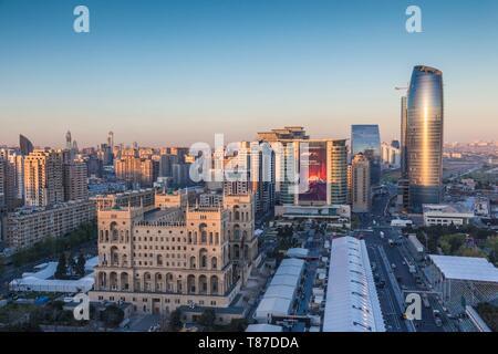 Azerbaijan, Baku, high angle skyline with Dom Soviet Government House, dusk - Stock Photo