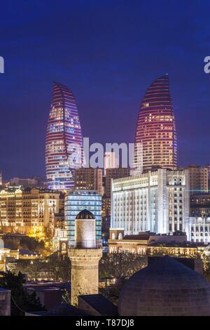 Azerbaijan, Baku, high angle skyline view with The Flame Towers, dusk - Stock Photo