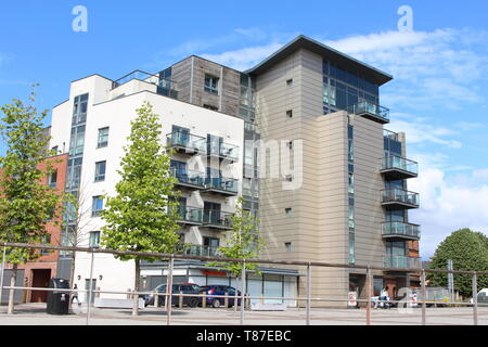 10 May 2019: Cardiff Bay, Cardiff UK:  A block of flats in Cardiff Bay with cladding.  Urban living concept. - Stock Photo
