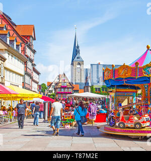 Quedlinburg, Germany - August 12, 2012: Fair in Markert Square and walking people in Quedlinburg - Stock Photo