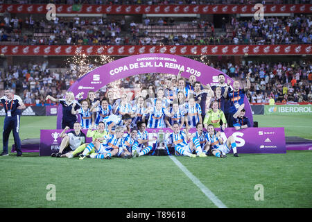 Granada, Andalucia, Spain. 11th May, 2019. Real Sociedad players celebrate with the trophy after winning Spanish Queen's Cup (Copa de la Reina) final match Real Sociedad vs At. de Madrid at Los Nuevos Carmenes Stadium on May 12, 2019 in Granada, Spain Credit: Jack Abuin/ZUMA Wire/Alamy Live News - Stock Photo