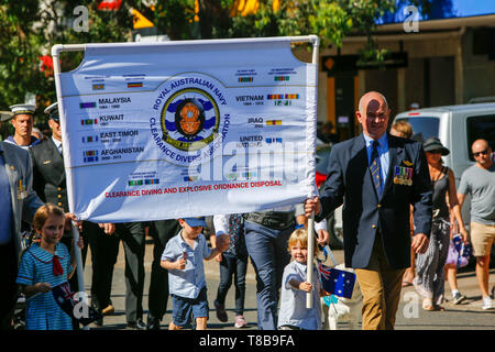 Australia ANZAC Day march with members of the Royal Australian navy and clearance divers , with local school children,Sydney,Australia - Stock Photo