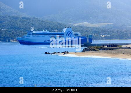 France, Corse du Sud, Propriano, Lido beach and the lighthouse in the background, La Meridionale ferry departure - Stock Photo