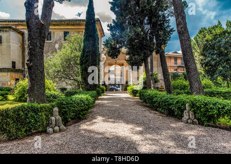 The old entrance of Casale di San Pio V (Saint Pio V House) opening to the Italian Garden of the park and the symbols of Chigi Family that bought the residence in the seventeenth century, in Rome, Italy - Stock Photo