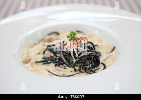Spaghetti ink squid - Stock Photo