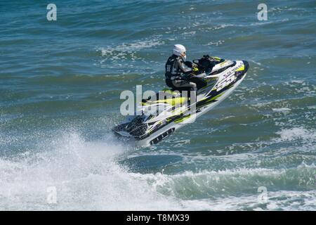 Huntington Beach, CA - April 7 2019: Jet skier competing in offshore PWC surf race at 2nd Annual Huntington Beach Moto-Surf and Freeride Exhibition. - Stock Photo