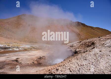 Watching a geyser erupt along the Rio Blanco, El Tatio, San Pedro de Atacama, Chile - Stock Photo