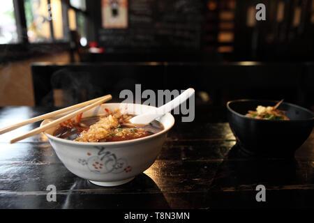 Udon noodles with shrimp tempura - Stock Photo