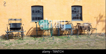 TASMANIA, AUSTRALIA - MARCH 4, 2019: Old wagons lined up in front of an outbuilding at  Clarendon House, near the town of Evandale in Tasmania. - Stock Photo