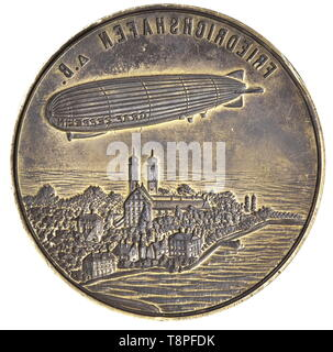 A ship's seal of the 'Graf Zeppelin' airship A large brass seal with the air ship LZ 127 'Graf Zeppelin' above the city of Friedrichshafen on the Bodensee cut into the surface of the seal. The inscription, 'BORDSIEGEL D-LZ 127 'GRAF ZEPPELIN' WELT-FAHRT 1929' ('SHIP'S SEAL D-LZ 127 'GRAF ZEPPELIN' ROUND THE WORLD VOYAGE 1929') is engraved on the stepped rim. Finely turned hardwood grip. Height 11.5 cm. The 'Graf Zeppelin' was 236.6 m long with a diameter of 30.5 m and a buoyant gas volume of 105,000 cubic meters. It was built in Friedrichshafen b, Additional-Rights-Clearance-Info-Not-Available - Stock Photo