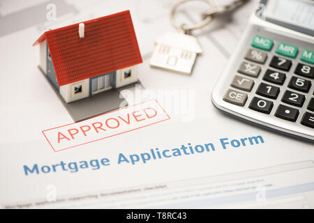 Approved mortgage loan agreement application - Stock Photo