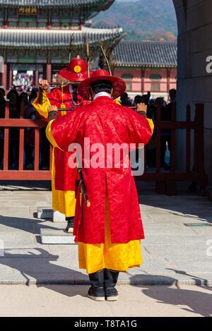 Changing of the Royal Guard Ceremony at Gwanghwamun Gate (The main gate) of Gyeongbokgung Palace - Stock Photo