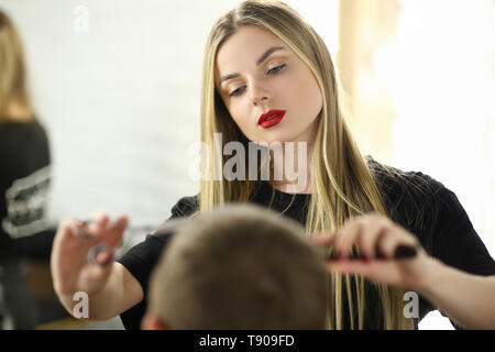 Barber Woman Cutting Male Hair in Barbershop Salon - Stock Photo