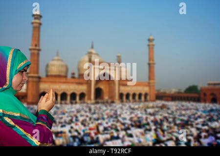 Muslim Devotees offer Eid-ul-fitr prayers at Jama Masjid - Stock Photo