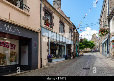Paimpol, France - July 28, 2018: Picturesque street in the old town of Paimpol, Brittany - Stock Photo