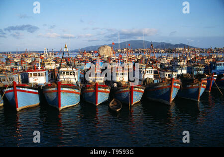 Vietnam. Nha Trang. Rows of moored fishing boats in harbour. - Stock Photo