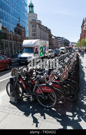 LONDON, UNITED KINGDOM - May 14, 2019: London public bicycles lined up along the side of the street in the City of London. - Stock Photo
