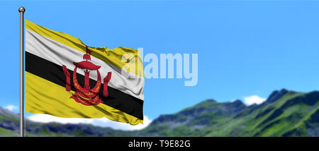 Brunei flag waving in the blue sky with green fields at mountain peak background. Nature theme. - Stock Photo
