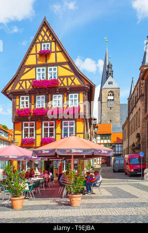 Quedlinburg, Germany - August 12, 2012: Town square and cafe near old house in Quedlinburg - Stock Photo