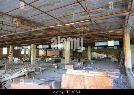 Abandoned Supermarket in the Ghost Town of Pripyat, Chernobyl zone, Ukraine - Stock Photo