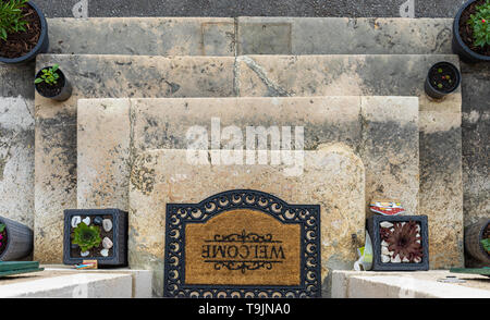 Top view on entrance the house with stone stairs and flowers decoraton. Outdoor photography - Stock Photo
